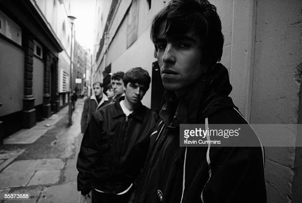 British rock group Oasis, London, 17th March 1994. Left to right: rhythm guitarist Paul 'Bonehead' Arthurs, bassist Paul McGuigan, drummer Tony...