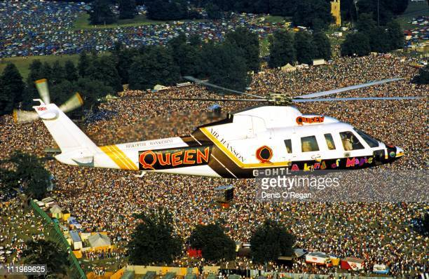 British rock group Queen arrive by helicopter for a concert at at Knebworth House Hertfordshire, on the group's 'Kind of Magic' tour, 1986.