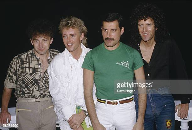 British rock group Queen from left to right bassist John Deacon drummer Roger Taylor singer Freddie Mercury and guitarist Brian May 1985