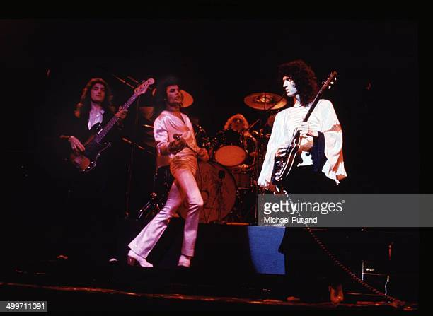British rock group Queen perform on stage in London 1974 LR Bassist John Deacon singer Freddie Mercury drummer Roger Taylor and guitarist Brian May
