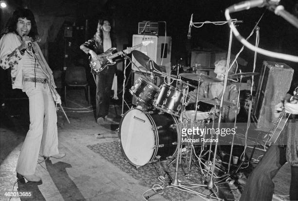 British rock group Queen rehearsing for their first major tour, 8th July 1973. Left to right: Freddie Mercury , John Deacon, Roger Taylor and Brian...