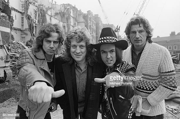 British rock group Slade at a demolition site UK 25th February 1981 Left to right bassist Jim Lea singer Noddy Holder guitarist Dave Hill and drummer...