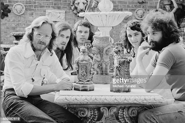 British rock group Supertramp July 1974 Left to right saxophonist John Helliwell bassist Dougie Thomson drummer Bob Siebenberg singer and guitarist...