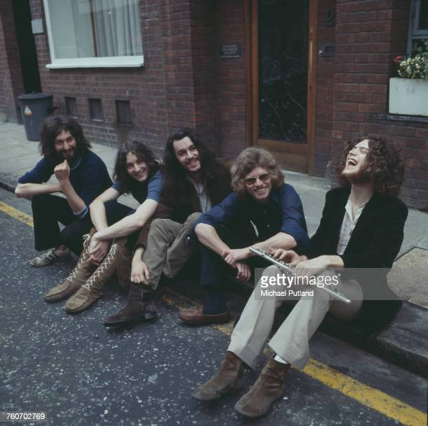 British rock group Supertramp posed together sitting on the pavement outside the Revolution Club London August 1970 Left to right Rick Davies Roger...