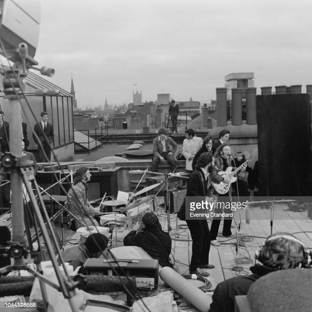 British rock group the Beatles performing their last live public concert on the rooftop of the Apple Organization building for director Michael...