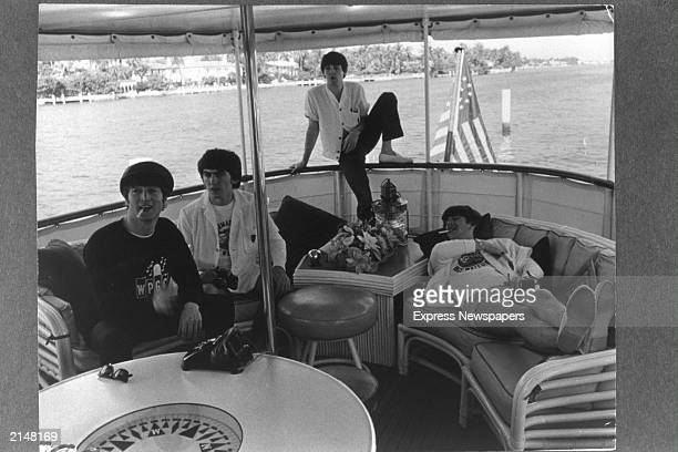 British rock group The Beatles relax on a boat off the coast of Miami Florida February 1964 LR John Lennon George Harrison Paul McCartney and Ringo...