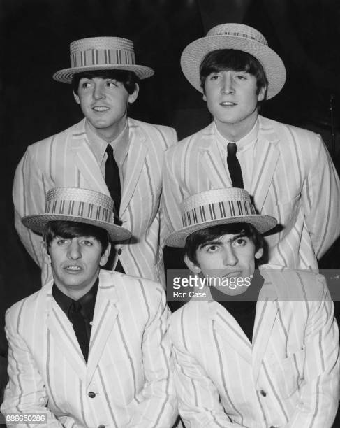 British rock group the Beatles wearing blazers and straw boaters during rehearsals for a television show with Morecambe and Wise at the Elstree...
