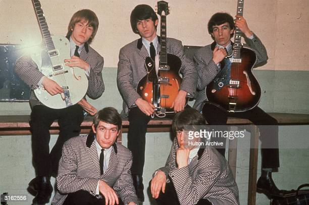 British rock group the Rolling Stones comprising drummer Charlie Watts frontman Mick Jagger guitarists Keith Richards and Brian Jones and bassist...