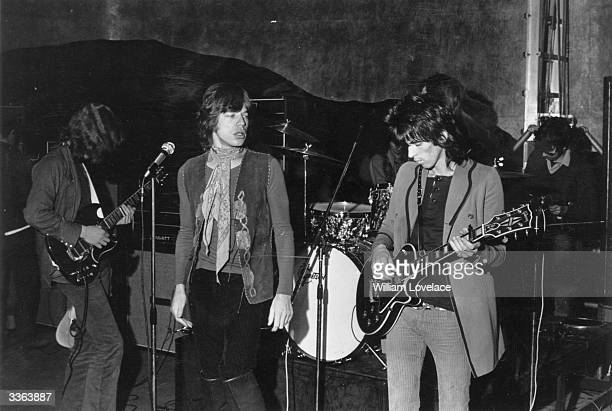 British rock group The Rolling Stones in concert at the Saville Theatre London From left to right new guitarist Mick Taylor singer Mick Jagger and...