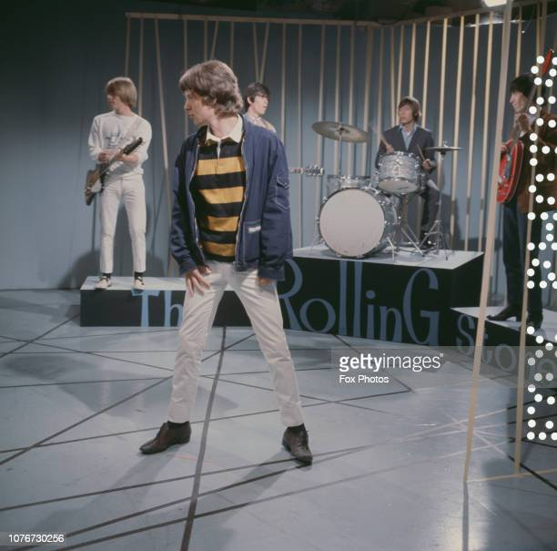 British rock group The Rolling Stones perform on a television show October 1965 From left to right they are Brian Jones Mick Jagger Keith Richards...