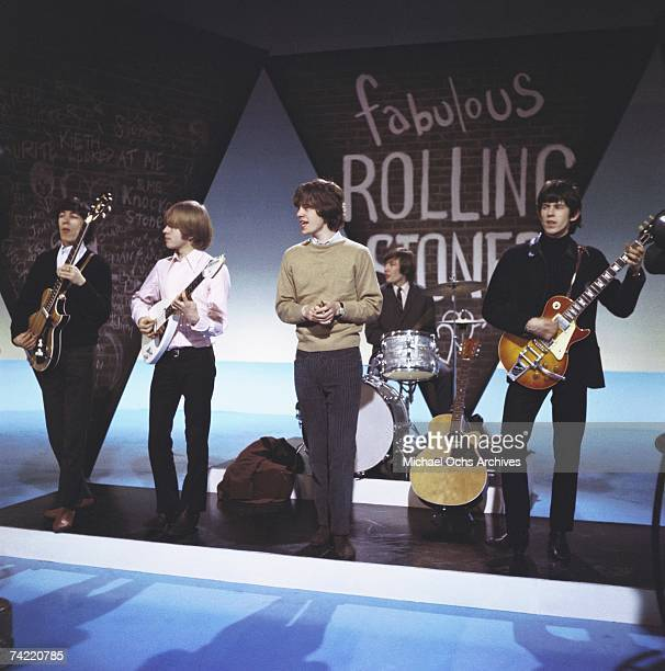 British Rock Group 'The Rolling Stones' perform on a TV Show in London England circa 1965 Left to right Bill Wyman Brian Jones Mick Jagger Charlie...