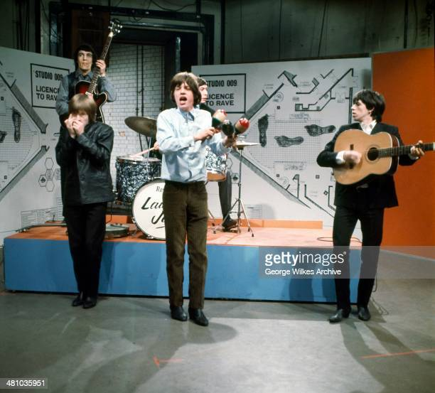 British rock group The Rolling Stones perform on an episode of a television show London England 1969 Pictured are front row from left Brian Jones...