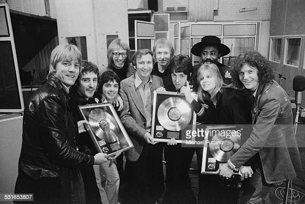 British rock group Wings and others pose with platinum discs for the Wings album 'Band On The Run', at Abbey Road Studios, London, 15th November...