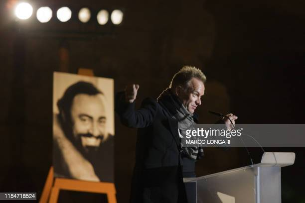 British rock icon Sting gestures as he speaks at a memorial event in honour of the late Italian tenor Luciano Pavarotti whose portrait stands on an...