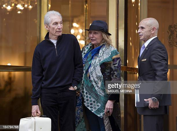 British rock legend and drummer of The Rolling Stones band Charlie Watts beside his wife Sherley stands in front of the Bristol hotel in Paris on...