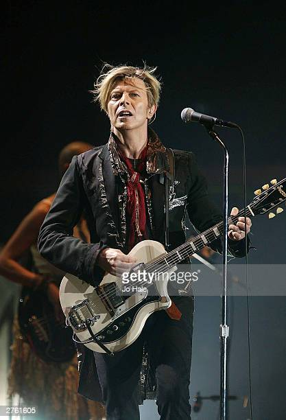 British rock legend David Bowie performs on the first night of the London leg of his tour at Wembley Arena on November 25 2003 in London