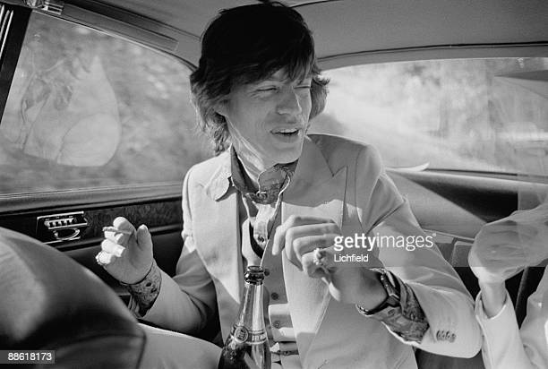 British rock musician Mick Jagger in the wedding car after his marriage to Nicaraguan model actress and human rights advocate Bianca Perez Morena de...