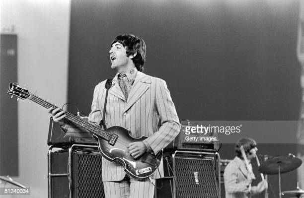 1966 British rock musician Paul McCartney playing on stage during The Beatles' last tour Drummer Ringo Starr is visible in the background