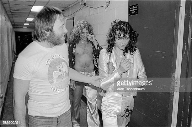British Rock musicians Jimmy Page and Robert Plant of the group Led Zeppelin as they walk backstage at Madison Square Garden New York New York June...