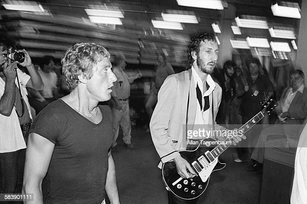 British Rock musicians Roger Daltry and Pete Townshend both of the group the Who walk backstage at Madison Square Garden New York New York March 3...