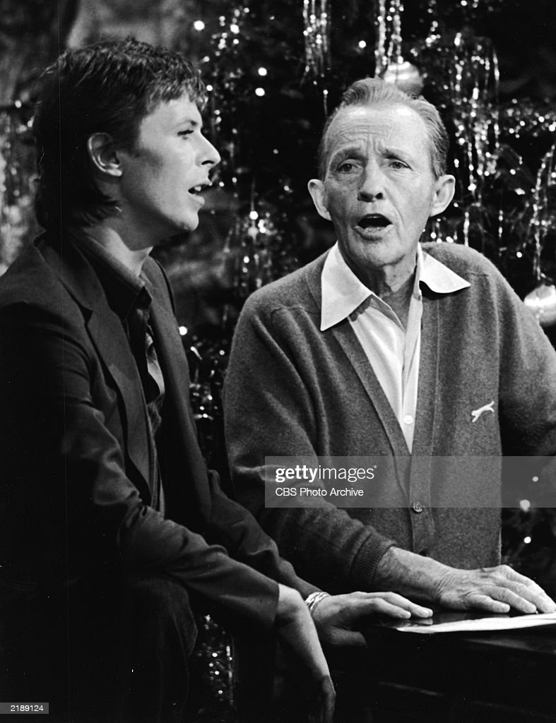 British rock singer and actor David Bowie performs with American pop singer Bing Crosby for the TV special, 'Bing Crosby's Merrie Olde Christmas,' London, England.
