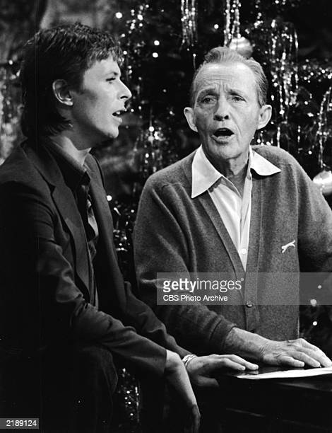 British rock singer and actor David Bowie performs with American pop singer Bing Crosby for the TV special 'Bing Crosby's Merrie Olde Christmas'...