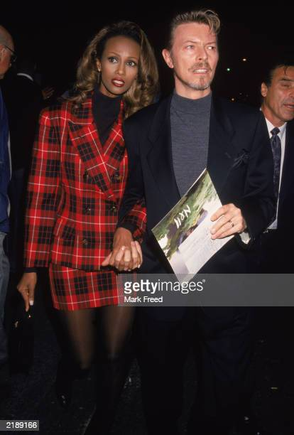 British rock singer David Bowie and his wife Iman attends the premiere of the film 'Nell' directed by Jodie Foster New York City 1994