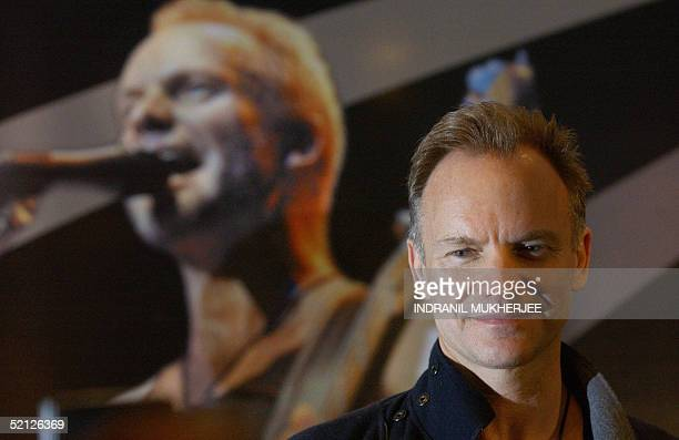 British rock singer Gordon Sumner better known as 'Sting' sits in front of a lifesize poster of himself as he addresses a press conference in...