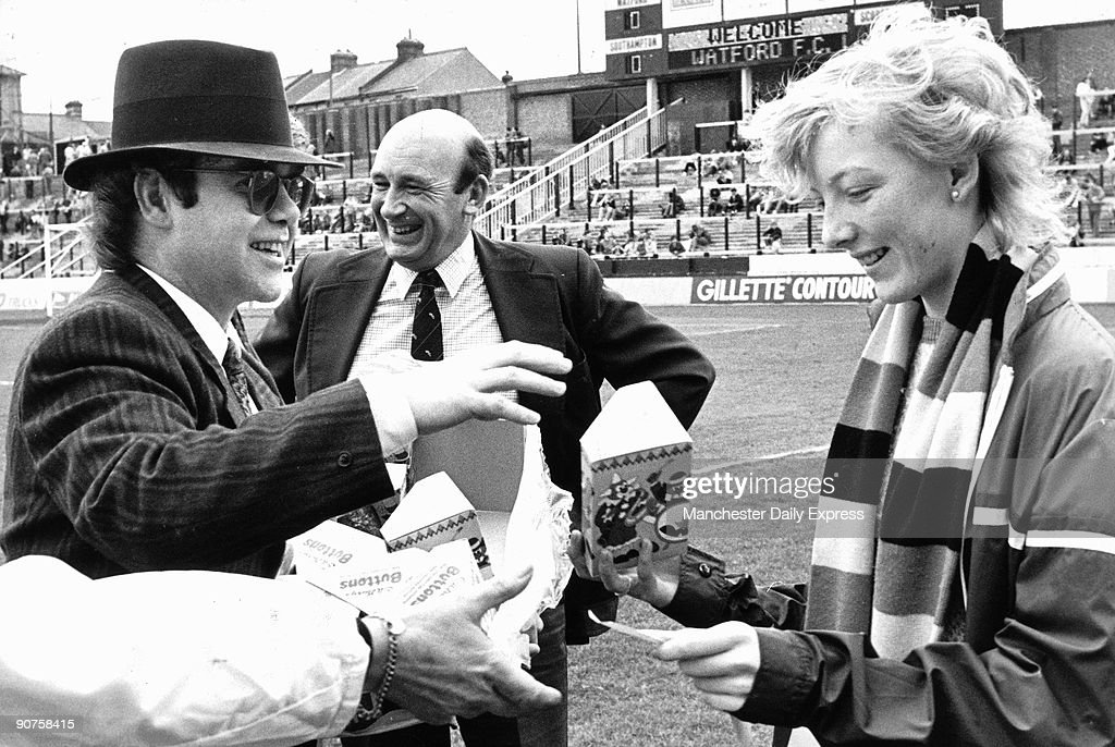 British rock star Elton John, chairman of Watford Football Club, chairman handing out Easter eggs to fans.