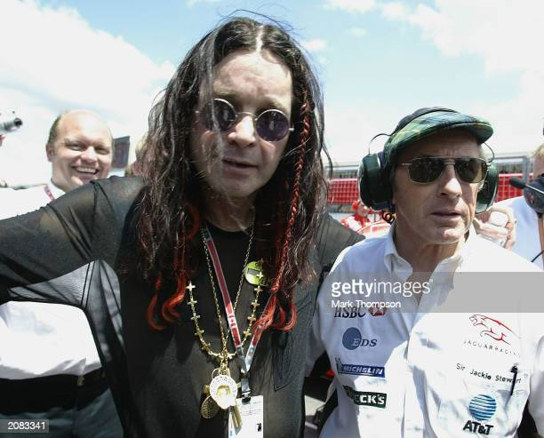 British rock star Ozzy Osbourne chats with Scottish race car driver Jackie Stewart of Jaguar before the Formula One Canadian Grand Prix at the...