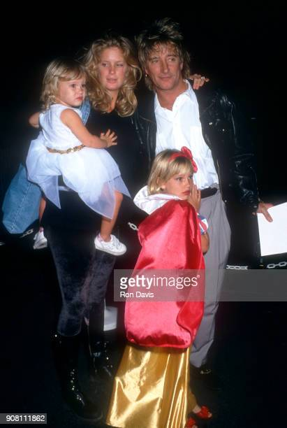 British rock star Rod Stewart poses with his wife New Zealandborn model Rachel Hunter along with his daughters Ruby and Renee during the Benefit...