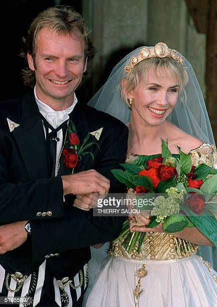 British rock star Sting holds his bride Trudie Styler prior to enter the church 22 August 1992 in Amesbury The couple who married earlier 20 August...
