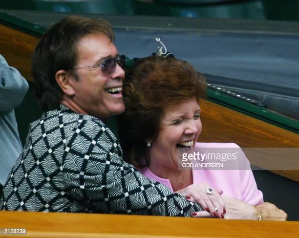 British rocker Sir Cliff Richard and Cilla Black laugh during the quarter final round match between Venus Williams of the US and Lindsay Davenport of...