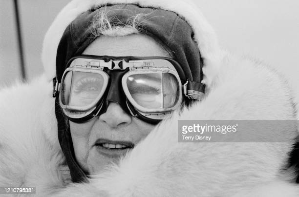 British romantic novelist Barbara Cartland wearing flying goggles and an aviator's cap in her glider, also called 'Barbara Cartland,' 11th April 1985.
