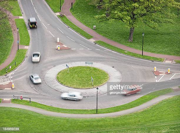 british roundabout traffic - taking a corner stock pictures, royalty-free photos & images