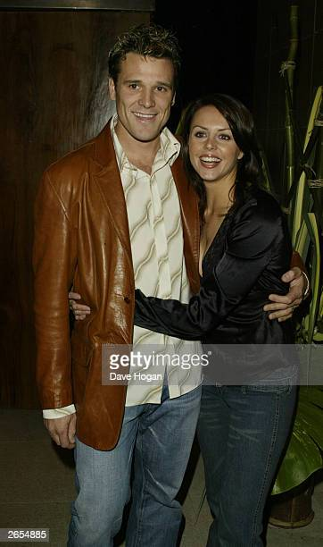 """British rower James Cracknell and his partner attend Westlife's """"Unbreakable"""" album launch at the Zuma Restaurant on November 11, 2002 in London."""