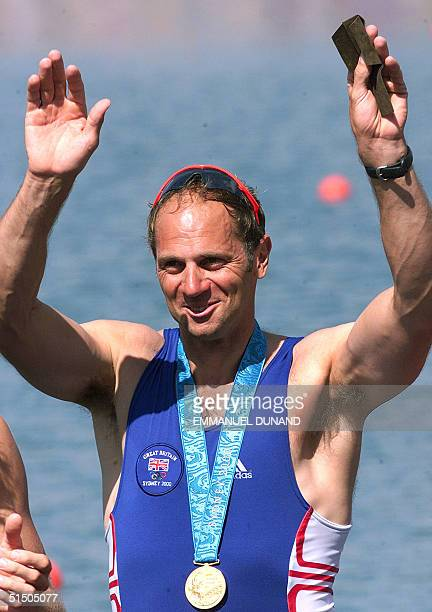 British rower Steven Redgrave celebrates after receiving his fifth Olympic gold medal 23 September 2000 after winning with teamates James Cracknell...
