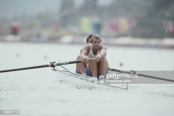 British rowers Andy Holmes and Steve Redgrave of the Great Britain team pictured during competition to reach and win the gold medal in the finals of...