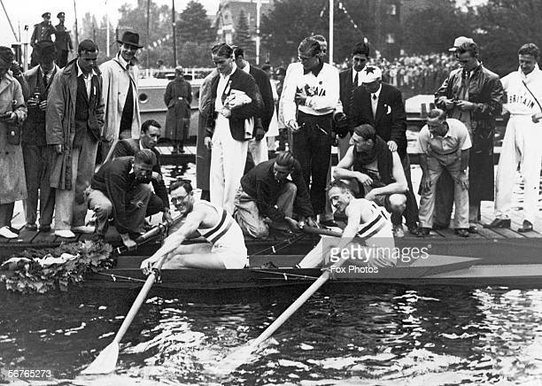 British rowers Leslie Frank 'Dick' Southwood and Jack Beresford rest their oars after winning the double sculls at the Berlin Olympics 14th August...