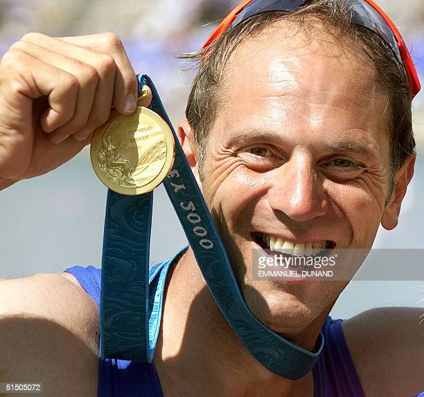 British rowing legend Steve Redgrave holds his record fifth Olympic gold medal 23 September 2000 after winning with teammates James Cracknell Tim...