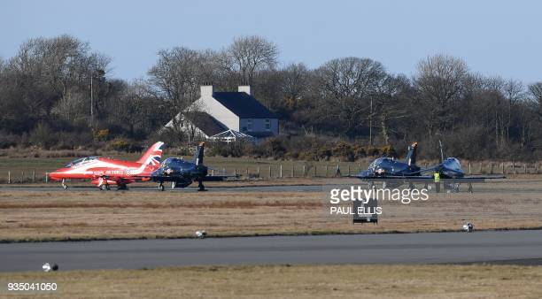 British Royal Air Force Hawk jets, including a Red Arrows aircraft, sit on the tarmac at RAF Mona air base in Anglesey, north Wales on March 20,...