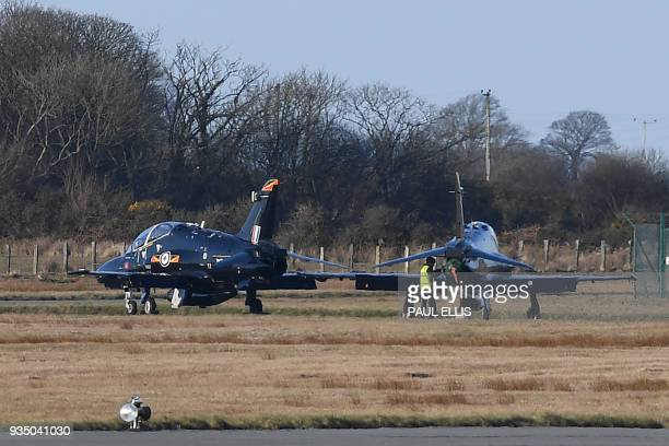 British Royal Air Force Hawk jets sit on the tarmac at RAF Mona air base in Anglesey, north Wales on March 20, 2018. A British military jet used in...