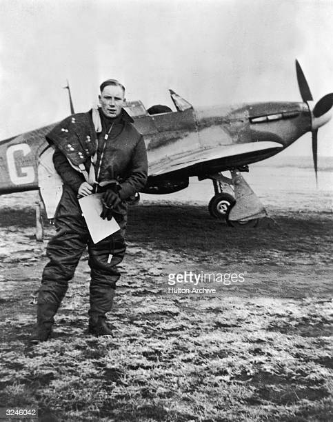 British Royal Airforce pilot Douglas Horne walks away from his Hawker Hurricane airplane after flying a sortie against the German Luftwaffe over the...