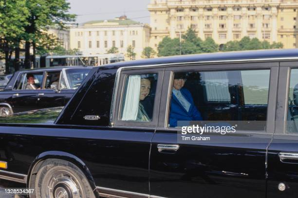 British Royal Anne, Princess Royal sitting alongside an unspecified woman in the backseat of a ZIL-4104 limousine during a visit to the Kremlin, the...