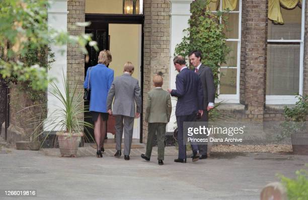 British Royal Diana, Princess of Wales , wearing a blue jacket over a black dress, with Prince William, Prince Harry, and Prince Charles and Eton...