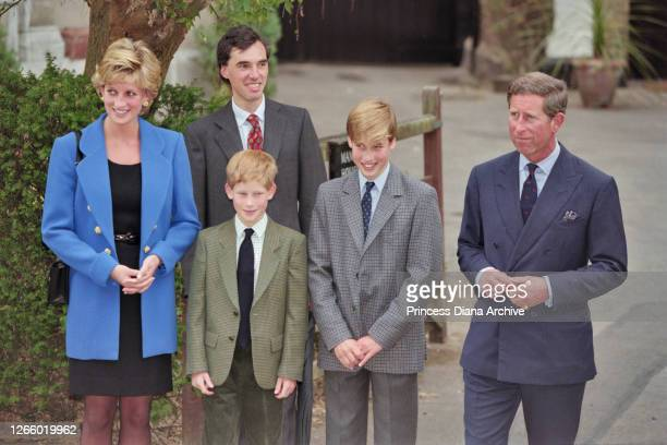 British Royal Diana, Princess of Wales , wearing a blue jacket over a black dress, with Eton housemaster Dr Andrew Gailey, Prince Harry, Prince...