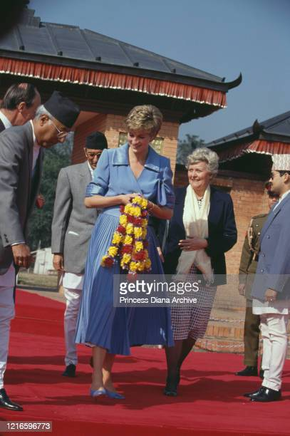 British royal Diana, Princess of Wales , wearing a blue outfit, carrying a garland on her arrival at Kathmandu airport at the end of her visit to...