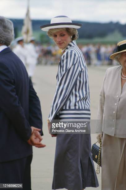 British royal Diana Princess of Wales wearing a blueandwhite striped jacket a dark blue skirt with a white hat with blue trim during a visit to...