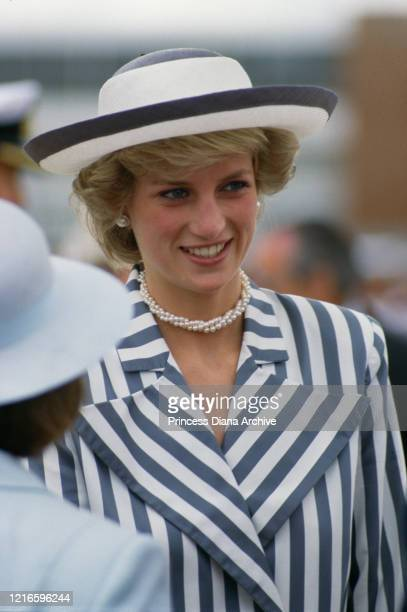 British royal Diana, Princess of Wales , wearing a blue-and-white striped jacket, a dark blue skirt with a white hat with blue trim, during a visit...
