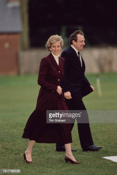British Royal Diana, Princess of Wales , wearing a burgundy outfit with an ivory polo neck top, prepares to leave following a visit to Oxford,...
